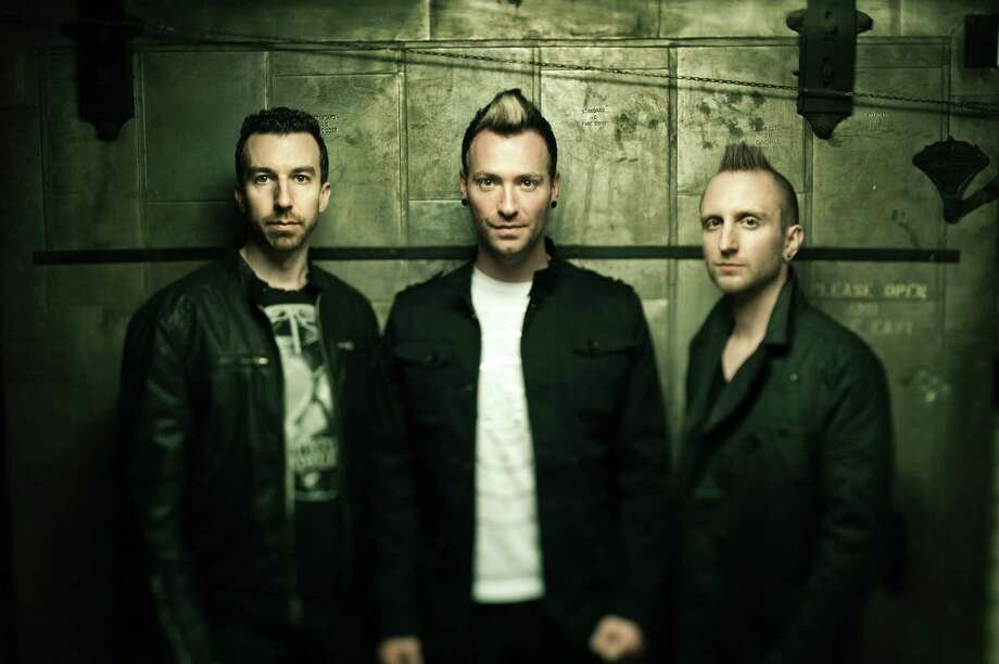 Thousand Foot Krutch includes Steve Augustine, from left, Trevor McNevan and Joel Bruyere. Photo: TFK Music
