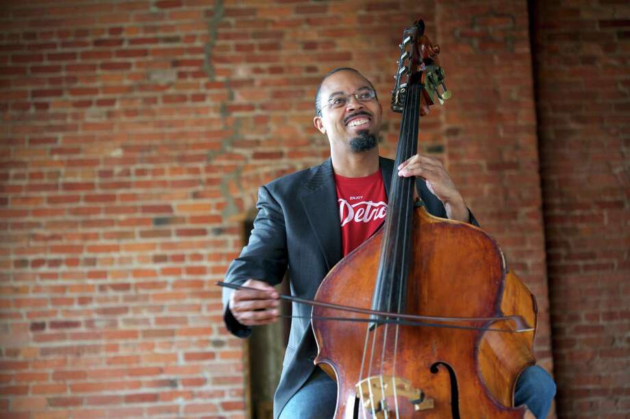 """Double-bass player Rick Robinson rearranged """"Gitcha Groove On"""" so it could be performed by the 40-piece River Oaks Chamber Orchestra. Photo: Courtesy Of CutTime"""