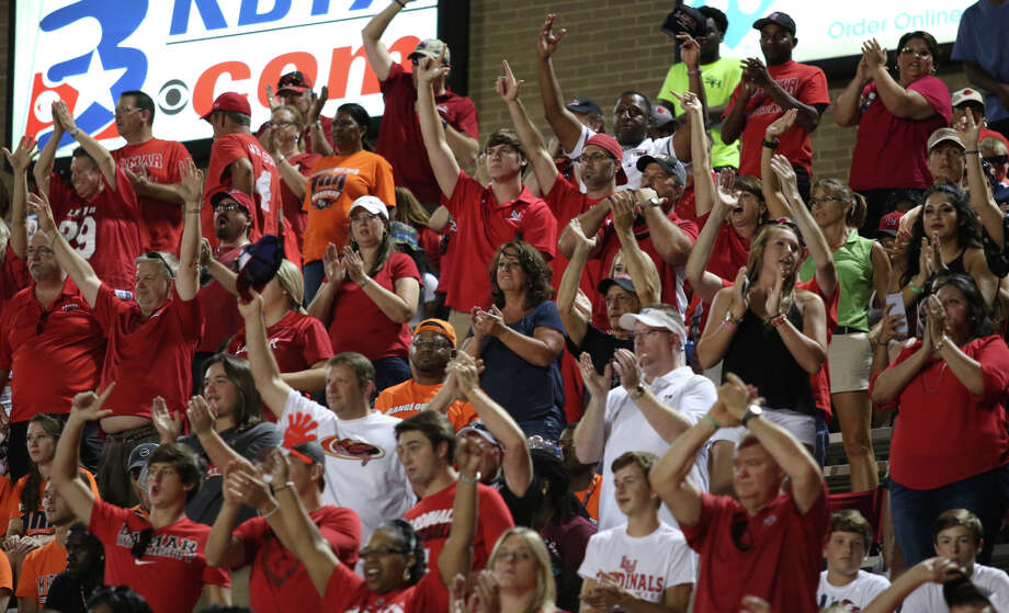 Cardinal fans react to the team as they exit for halftime leading 35-14 during the game between the Lamar Cardinals and the Sam Houston State Bearkats at Bowers Stadium in Huntsville, Saturday night, September 19th, 2015 - photo provided by Kyle Ezell