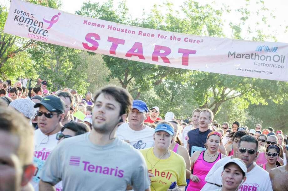 Houston's Susan G. Komen Race For the Cure draws thousands of walkers and runners to the annual downtown event. Photo: Jamaal Ellis, Freelance / ©2013 Houston Chronicle