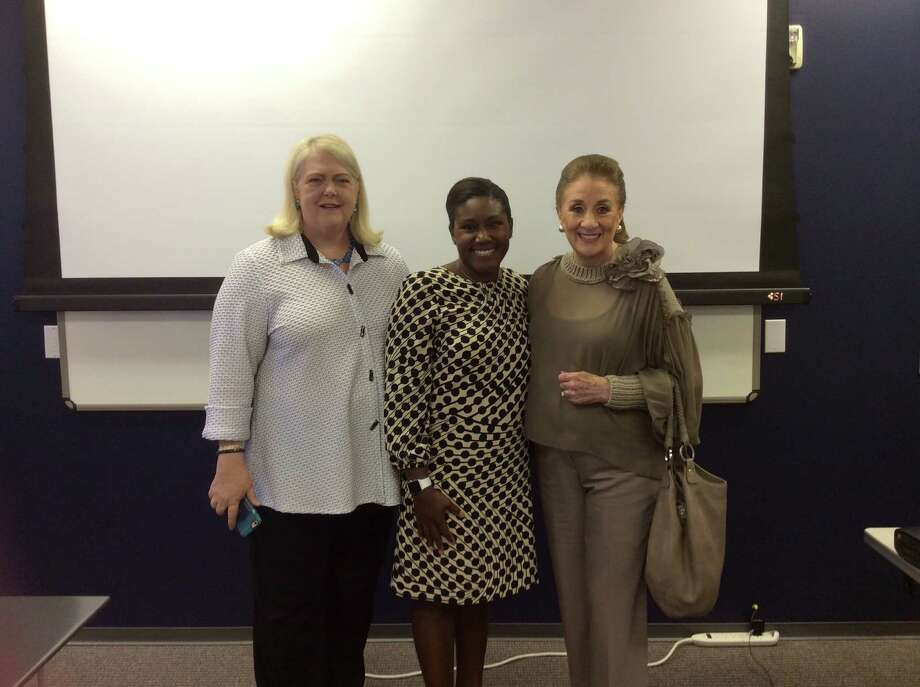 Marilyn Thompson, vice president of sales; Aisha Crumbine; and Martha Turner gather at a recent Martha Turner Sotheby's International Realty sales meeting.