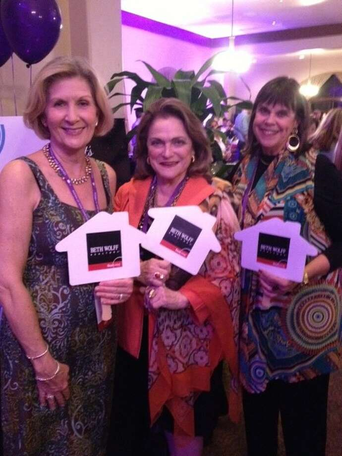 Enjoying the recent Women of Wine Charities Grand Tasting are event supporters Debbie Gaffney, Beth Wolff and Pamela Greenwood of Beth Wolff Realtors Real Living.