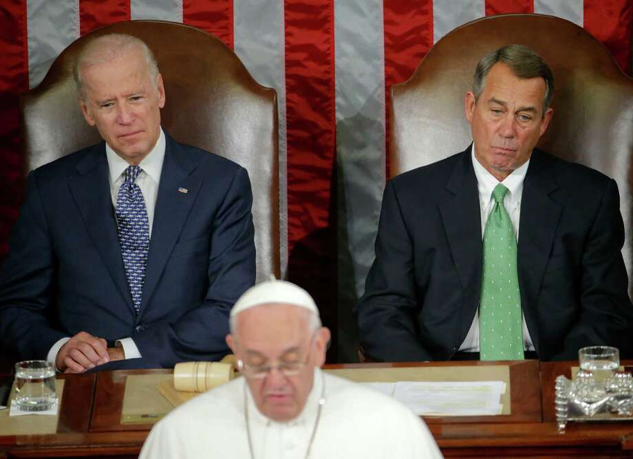 Some are saying that Pope Francis' address to Congress Thursday provided inspiration for John Boehner's resignation as House Speaker. Vice President Joe Biden and Boehner listen to the pope as he addresses Congress. Photo: Pablo Martinez Monsivais /Associated Press / AP