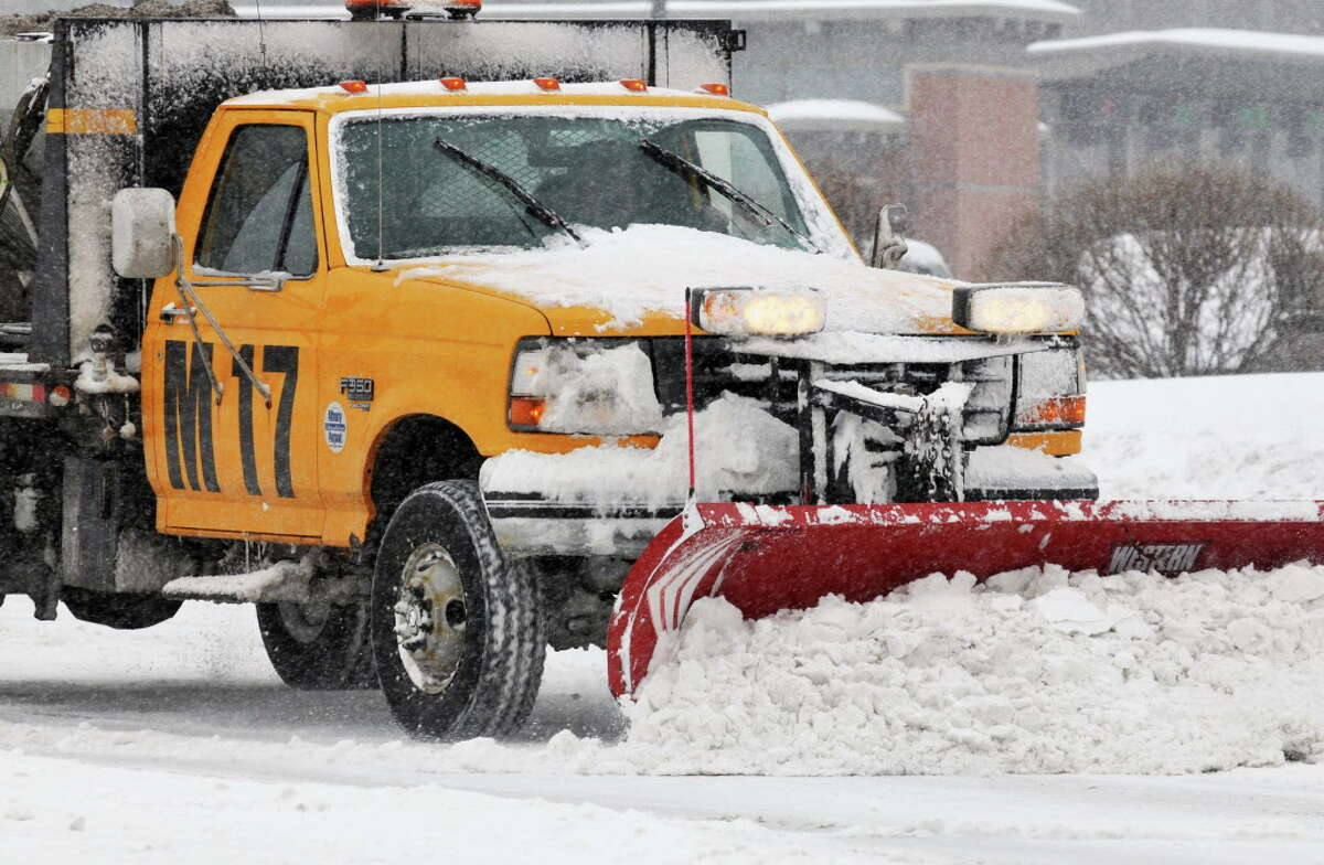 A snowplow works to clear snow at Albany International Airport in Colonie Tuesday morning February 1, 2011. (John Carl D'Annibale / Times Union)