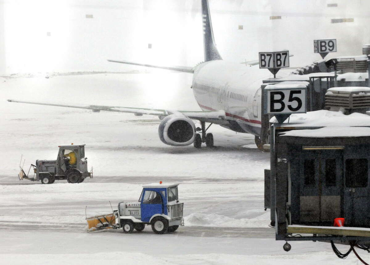 Crews plow snow at the passenger gates at Albany International Airport in Colonie Tuesday morning February 1, 2011. (John Carl D'Annibale / Times Union)