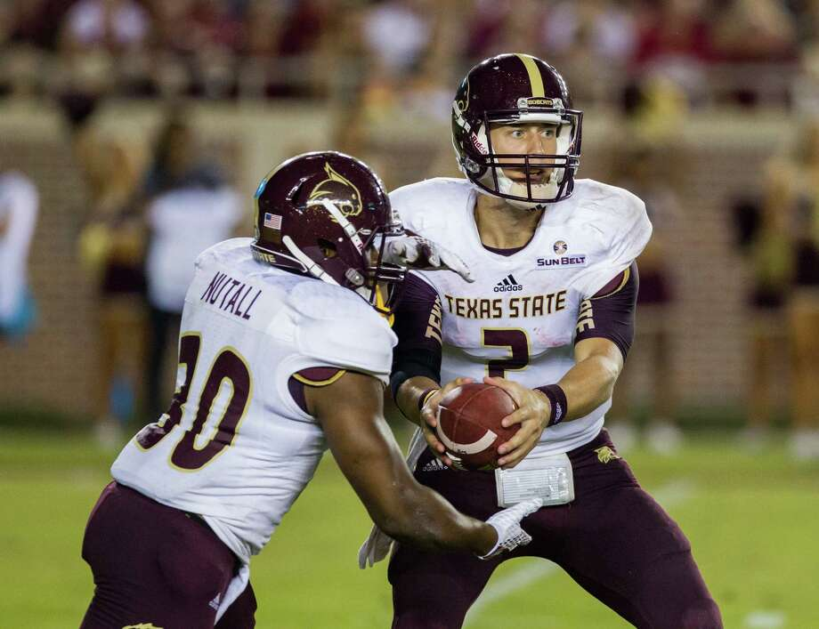 Texas State quarterback Tyler Jones fakes a handoff to Chris Nutall during a season opening game against Florida State. The Bobcats have more than a few defensive woes and have been exposed by opposing offenses. Photo: Mark Wallheiser, FRE / FR171224 AP