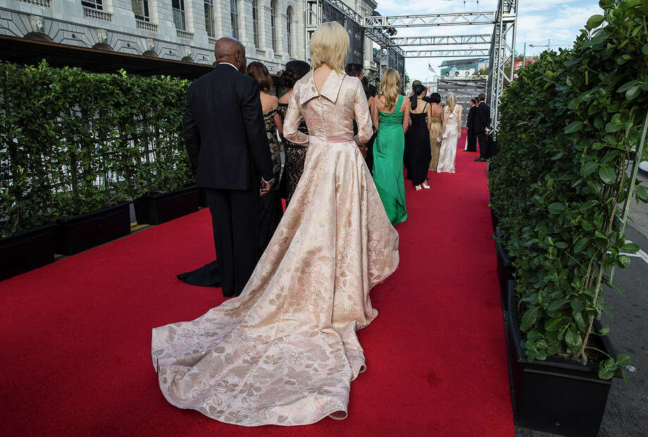 Sonya Molodetskaya (center) walks a red carpet set up on Grove Street wearing a gown by Vasily Vein on her way into the San Francisco Symphony's 2015 Opening Gala at Davies Symphony Hall in San Francisco, Calif., on Thursday, September 24, 2015. The gala celebrated the opening of the symphony's 104th season and proceeds from the event benefit the symphony's education and community programs. Photo: Laura Morton, Special To The Chronicle / Laura Morton / ONLINE_YES