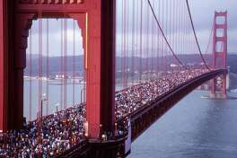 SAN FRANCISCO - MAY 1987: The Golden Gate Bridge 50th Anniversary Bridge Walk in May 1987. (Photo by Ed Perlstein/Redferns/Getty Images)