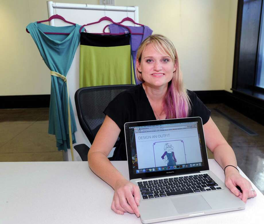 "Theresa ""Tree"" McDermott displays her web site ""Tree's Clothing"" that allows women to custom design their own clothes using templates on the site, at the Stamford Innovation Center at 175 Atlantic Street in Stamford, Conn., Thursday, Sept. 24, 2015. In the background are clothing samples that were created using the site. Photo: Bob Luckey Jr. / Hearst Connecticut Media / Greenwich Time"