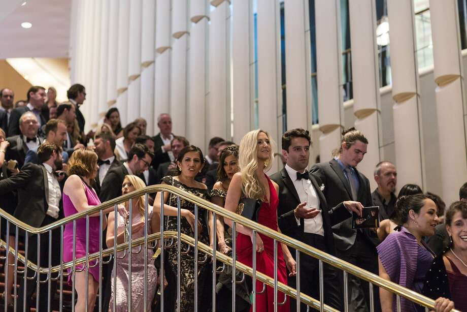 Guests of the San Francisco Symphony's 2015 Opening Gala make their way down the stairs at Davies Symphony Hall on their way to the after party after the performance in San Francisco, Calif., on Thursday, September 24, 2015. The gala celebrated the opening of the symphony's 104th season and proceeds from the event benefit the symphony's education and community programs. Photo: Laura Morton, Special To The Chronicle