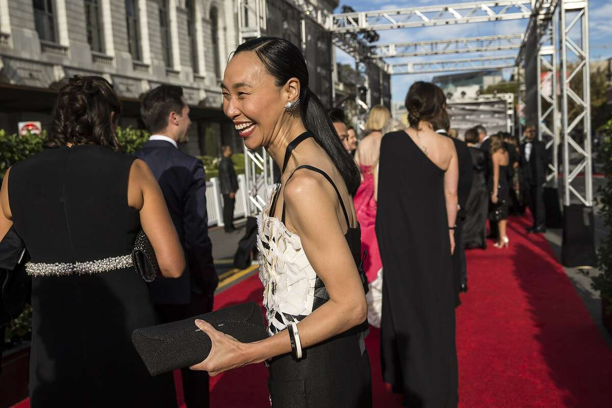 Dr. Carolyn Chang (center) walks a red carpet set up on Grove Street after arriving to attend the San Francisco Symphony's 2015 Opening Gala at Davies Symphony Hall in San Francisco, Calif., on Thursday, September 24, 2015. The gala celebrated the opening of the symphony's 104th season and proceeds from the event benefit the symphony's education and community programs.