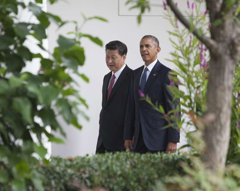 WASHINGTON, DC - SEPTEMBER 25: US President Barack Obama and President XI Jinping of China walk to the Oval Office after participating in an official State Visit on the South Lawn of the White House September 25, 2015 in Washington, DC. Later in the day Obama will meet with Xi in the Oval Office and also hold a joint news conference with the Chinese leader  (Photo by Chris Kleponis-Pool/Getty Images) Photo: Pool, Getty Images