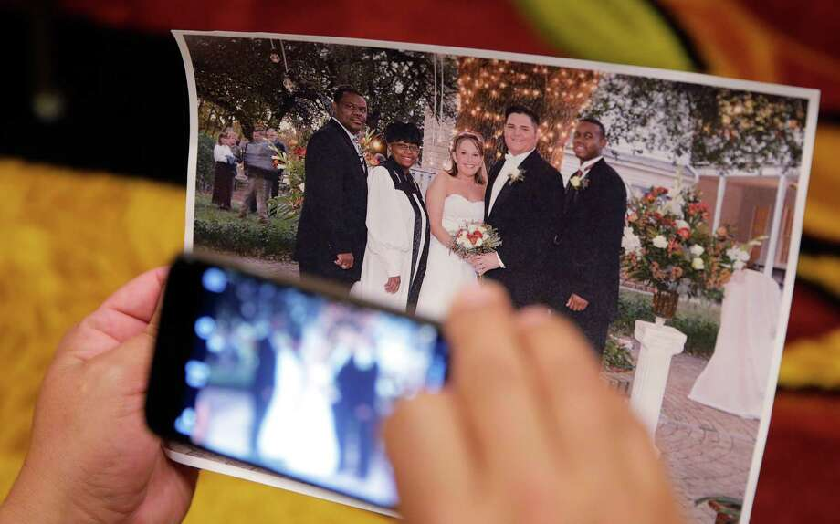 A member of the media copies a photo showing high school referee Robert Watts, second from right, at his wedding. The photo was shown at the University Interscholastic League State Executive Committee meeting, Thursday, Sept. 24, 2015, in Round Rock. Watts, the referee who was deliberately hit by two Jay football playerson Sept. 4, says through is attorney that he didn't call the players a profane racial slur. Photo: Eric Gay /Associated Press / AP