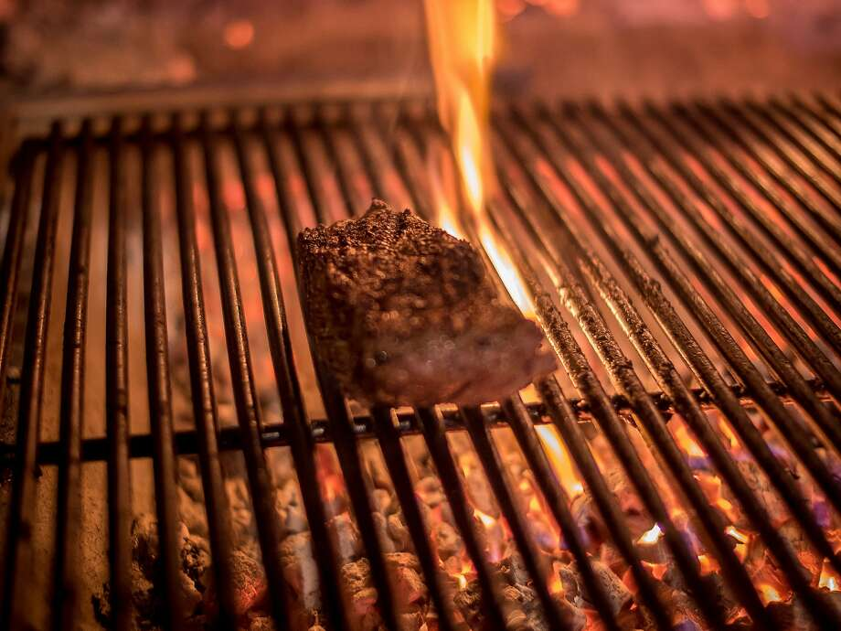 A steak cooking on the grill at the Advocate restaurant in Berkeley. Photo: John Storey, Special To The Chronicle
