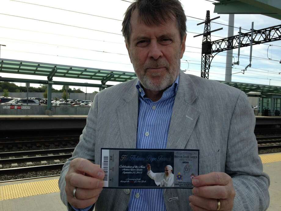 Brian Wallace, spokesman for the Diocese of Bridgeport, shows his ticket to the Papal Mass. Photo: Frank Juliano / Hearst Connecticut Media
