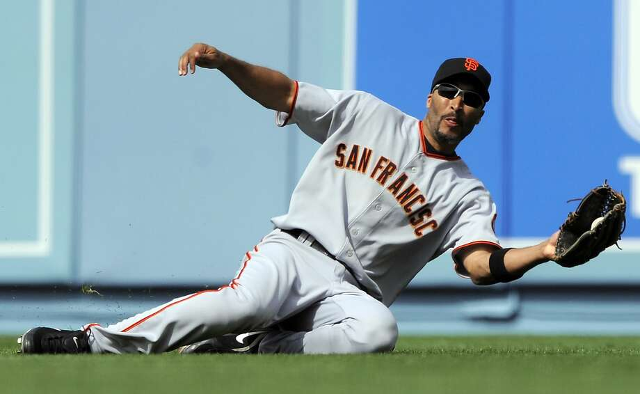 Giants right fielder Randy Winn makes a sliding catch on a ball hit by the Dodgers' Russell Martin during the sixth inning of a game April 13, 2009, in Los Angeles. Photo: Mark J. Terrill, AP