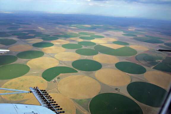 Technology already has improved farm irrigation methods dramatically. Here, center-pivot irrigated farms are seen in the Dallam County in the Texas Panhandle. The advent of center-pivot irrigation combined with low energy precision application, which applies water closer to the ground and reduces evaporation loss, has led to better farming yields with less water usage than in the past.