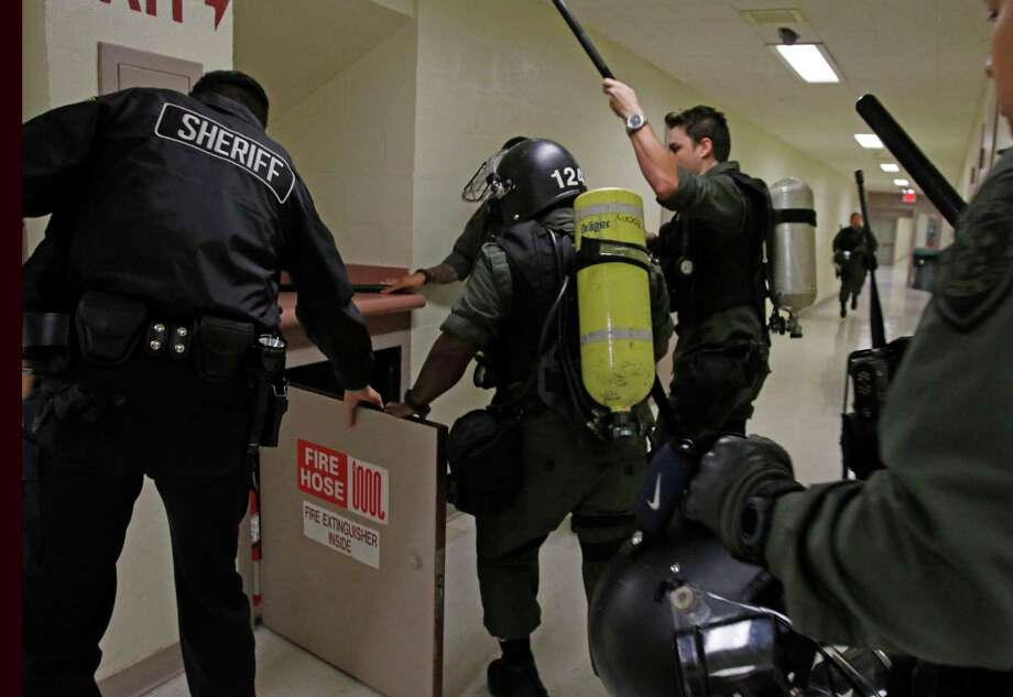 The Special Emergency Response Team practices during a drill at the Bexar County Sheriff Office. Photo: Ron Cortes /For The Express-News