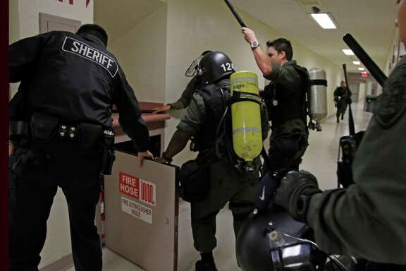 The Special Emergency Response Team practices during a drill at the Bexar County Sheriff Office.