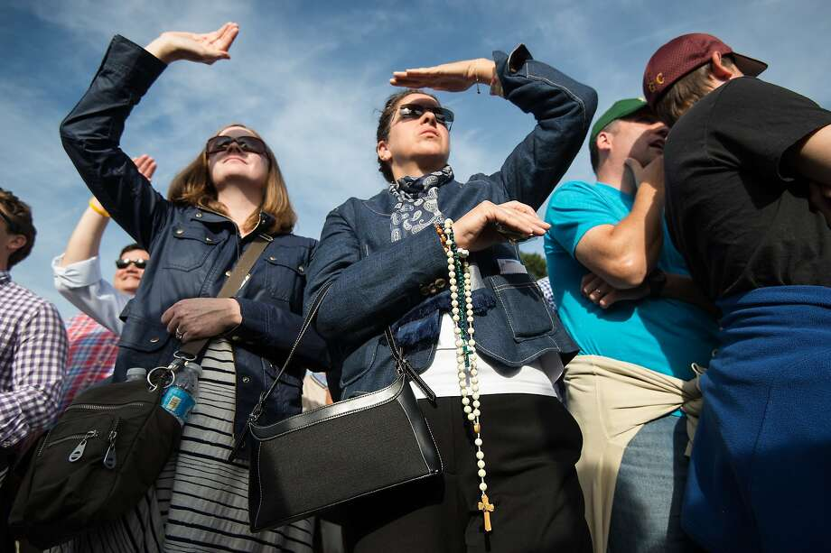 TOPSHOTS A woman holds rosary beads as she waits to watch Pope Francis address a Joint Session of Congress in front of the US Capitol in Washington, DC, on September 24, 2015 on the third day of his six-day visit to the US.  AFP PHOTO/NICHOLAS KAMMNICHOLAS KAMM/AFP/Getty Images Photo: Nicholas Kamm, AFP / Getty Images