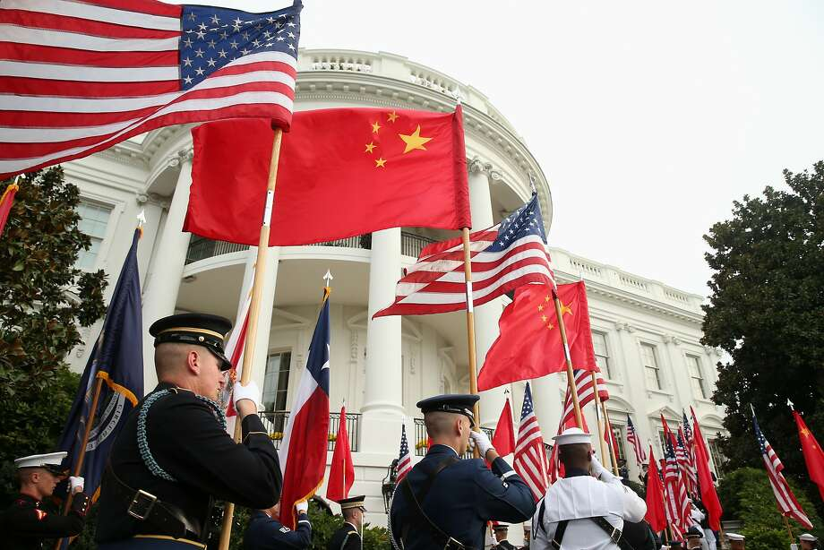 A military honor guard awaits the arrival of President Obama and Chinese President Xi Jinping at the White House. Photo: Andrew Harnik, Associated Press