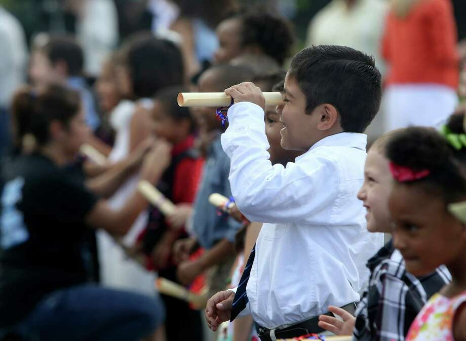 Among the initiatives accomplished during City Manager Sheryl Sculley's tenure has been voter approval of Pre-K for SA, giving San Antonio children more access to early childhood education. Izaiah Escobar, 5, uses his Pre-K 4 SA diploma as a telescope during the promotion ceremony of the 2013-2014 inaugural class in June 2014. Photo: Helen L. Montoya /San Antonio Express-News / ©2014 San Antonio Express-News