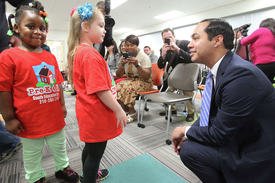 Mye'Uniq Washington (left) and Zoe McClure meet the mayor as Julian Castro helps to unveil the plans for additional education centers during ceremonies at the Southside Pre-K4 SA center on Feb. 19, 2014. Photo: Tom Reel /San Antonio Express-News / San Antonio Express-News