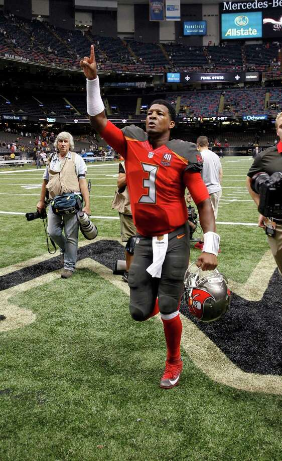 Tampa Bay Buccaneers quarterback Jameis Winston (3) acknowledges fans as he runs off the field after an NFL football game against the New Orleans Saints in New Orleans, Sunday, Sept. 20, 2015. The Buccaneers won 26-19. (AP Photo/Bill Haber) Photo: Bill Haber, FRE / FR170136 AP