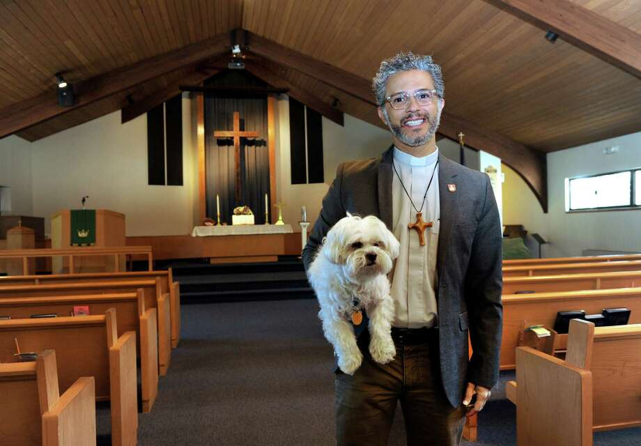 Pastor Alex Da Silva Souto brings his Maltese, Bilbao, to services at New Milford United Methodist Church. Photo: Carol Kaliff / Hearst Connecticut Media / The News-Times