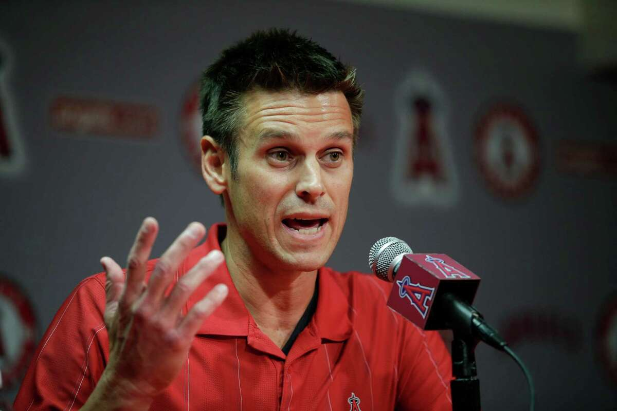 Los Angeles Angels General Manager Jerry Dipoto speaks to reporters during a news conference held before the team's exhibition baseball game against the Los Angeles Dodgers, Friday, April 3, 2015, in Anaheim, Calif. The Angels were surprised and disappointed by an arbitrator's decision not to discipline outfielder Josh Hamilton for his latest problems involving cocaine and alcohol. (AP Photo/Jae C. Hong)