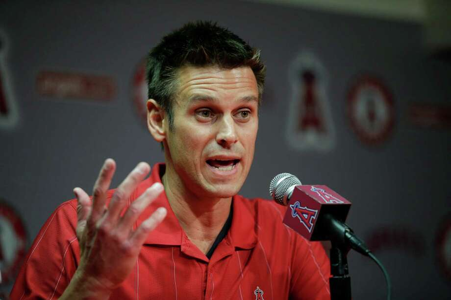 Los Angeles Angels General Manager Jerry Dipoto speaks to reporters during a news conference held before the team's exhibition baseball game against the Los Angeles Dodgers, Friday, April 3, 2015, in Anaheim, Calif. The Angels were surprised and disappointed by an arbitrator's decision not to discipline outfielder Josh Hamilton for his latest problems involving cocaine and alcohol. (AP Photo/Jae C. Hong) Photo: Jae C. Hong, Associated Press / AP