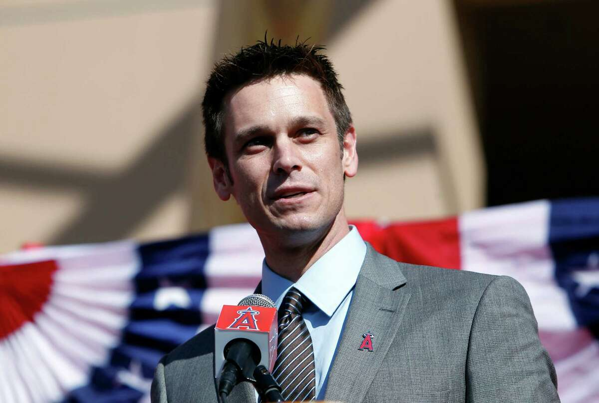 Los Angeles Angels general manager Jerry Dipoto speaks to introduce Albert Pujols and C.J. Wilson as the newest Angels at a news conference in Anaheim, Calif., Saturday, Dec. 10, 2011. (AP Photo/Alex Gallardo)