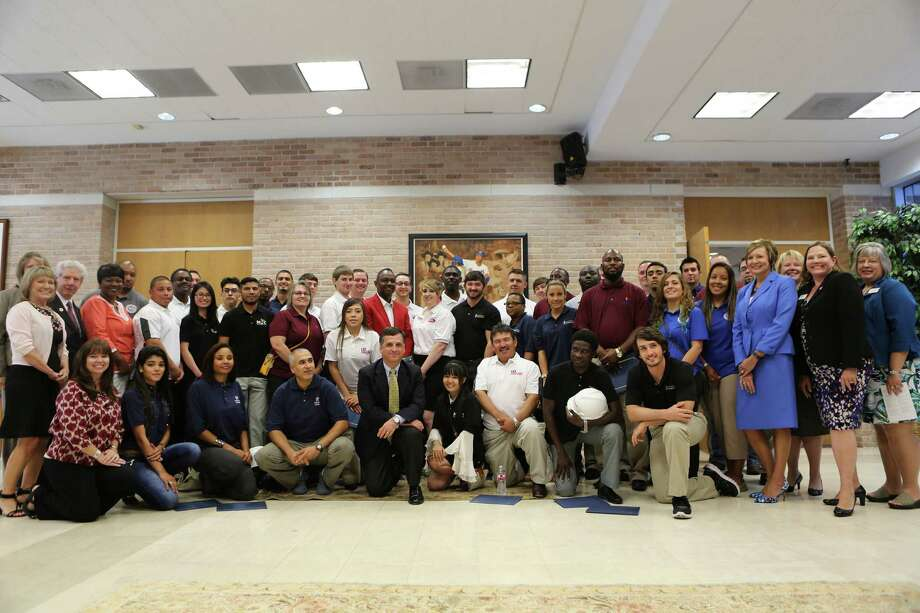 Representatives from nine community colleges and ExxonMobil gathered for a photo with recipients of the 2015 CCPI scholarship in the Nolan Ryan Center in Alvin following a luncheon for the recipients.