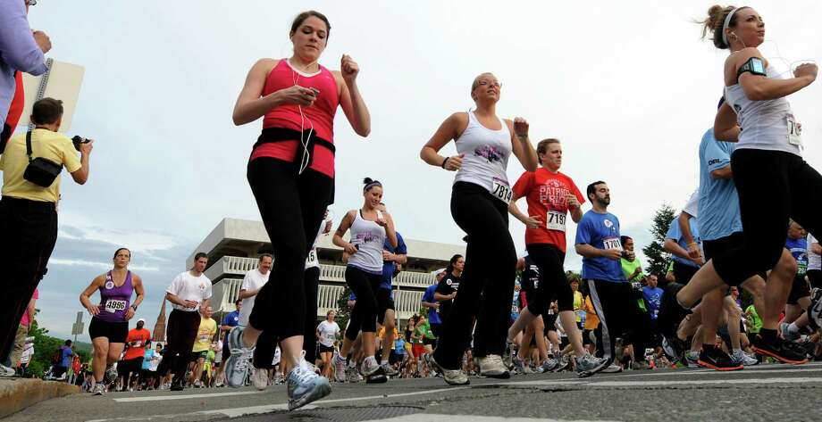 Runners tackle Madison Avenue during the Workforce Team Challenge 5K run in 2011, in Albany, N.Y. (Cindy Schultz / Times Union) Photo: Cindy Schultz / 00013205A