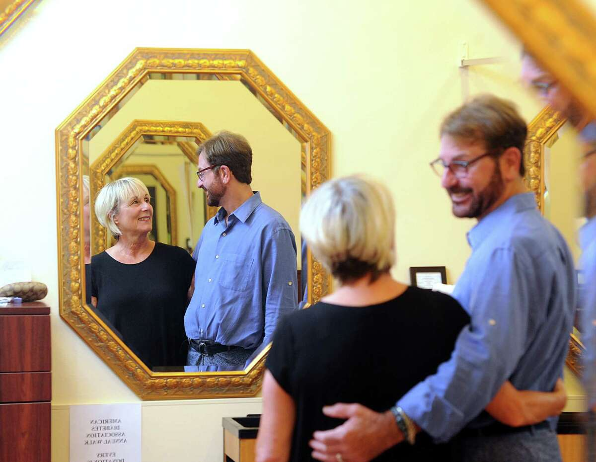 """""""A lot of marriages don't last this long,"""" said Peter Scifo, right, as his photo was being taken with Liz Gray, co-owners of Trendsetters Salon, who are celebrating being in business for 30 years, in their salon at 932 Hope Street in Stamford, Conn., Wednesday, Sept. 2, 2015."""