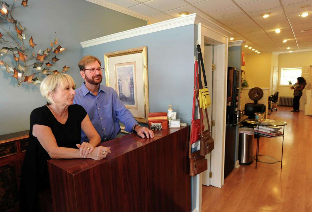 Liz Gray, left, and Peter Scifo, co-owners of Trendsetters Salon, are celebrating being in business for 30 years, in their salon at 932 Hope Street in Stamford, Conn., Wednesday, Sept. 2, 2015.
