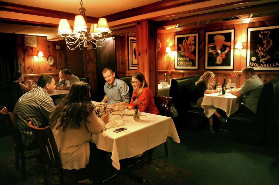 Diners fill the cozy dining room on Thursday, Aug. 27, 2015, at Cafe Capriccio in Albany, N.Y. (Cindy Schultz / Times Union) Photo: Cindy Schultz / 00033147A