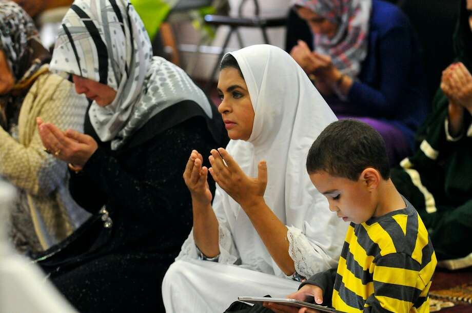 Azza Elkazzaz, Pottsville, Pa., prays during the Eid al-Adha prayer service at the Islamic Society of Schuylkill County in Pottsville, Pa., on Thursday morning, Sept. 24, 2015. (Jacqueline Dormer/The Republican-Herald via AP) Photo: Jacqueline Dormer, Associated Press