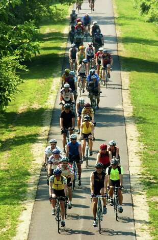 TIMES UNION STAFF PHOTO WILL WALDRON--Cyclists participating in the David Ryan Memorial Ride head down the Mohawk-Hudson bike trail in Niskayuna Saturday morning,  June 25 2005. The ride continued up Riverview Rd. in Clifton Park where Ryan, a 32 year-old General Electric Physicist, was killed by a speeding teenage motorist on June 29 2004 . Photo: WW / ALBANY TIMES UNION
