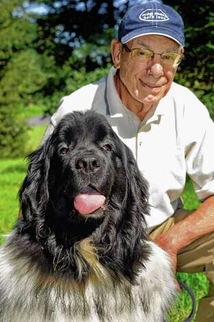 Orin Sussman and his therapy dog Elmo, a 7-yr.-old Newfoundland Black & White, at his home Friday August 7, 2015 in Colonie, NY.  (John Carl D'Annibale / Times Union) Photo: John Carl D'Annibale / 10032869A