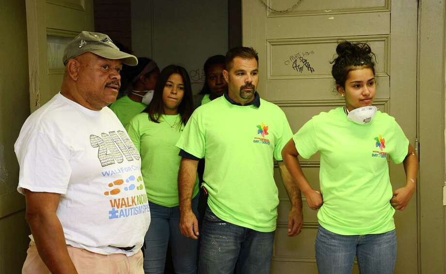James McCarley, left, gives a tour of the Harambee Youth Center in Danbury, Conn., to a group of volunteers from Western Connecticut State University on Friday, Sept. 25, 2015. McCarley is the president of the center's board of directors. Photo: Nelson Oliveira / Nelson Oliveira / The News-Times