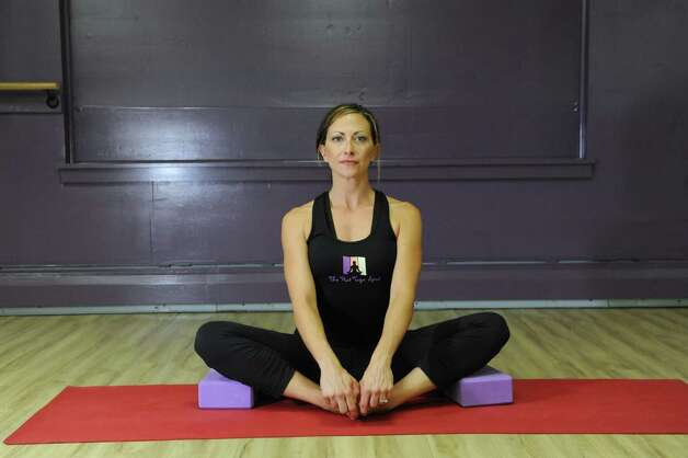 Yoga instructor Andrea Durkin does the Bound Angle representing Iyengar Yoga on Tuesday, Aug. 25, 2015, at The Hot Spot Yoga in Latham, N.Y. (Cindy Schultz / Times Union) Photo: Cindy Schultz / 00033087A