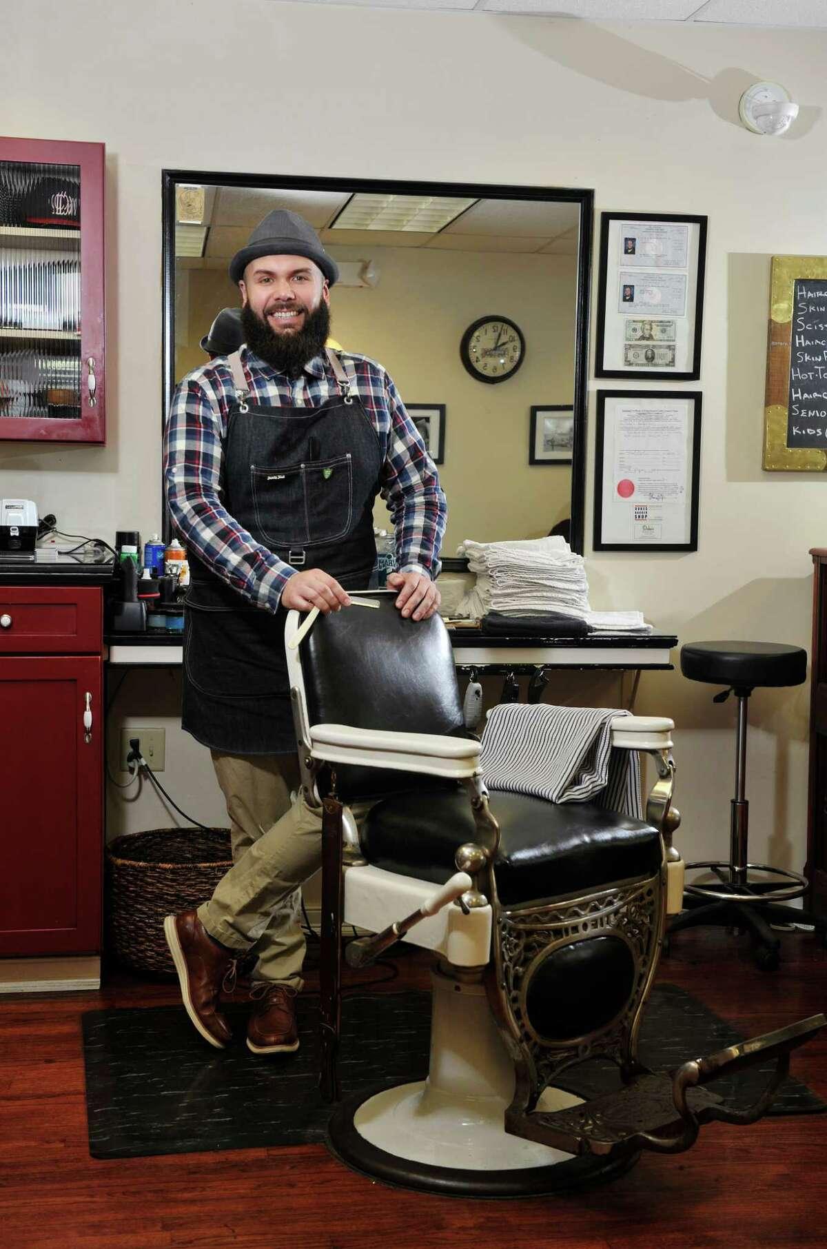 Duke (Mike Duker), owner of Duke's Barbershop in Albany, N.Y. (Paul Buckowski / Times Union)