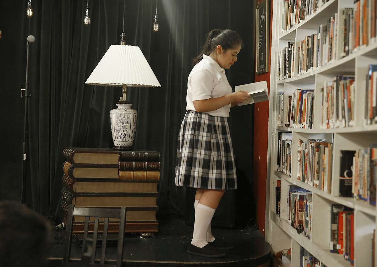 Mariangel Delgado, 13 years old, browses the shelves at the creative-writing tutoring program at 826 Valencia St. in San Francisco, Calif., on Thursday, September 24, 2015.