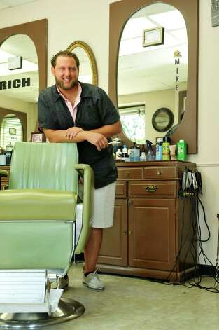 Wedgeway Barber Shop barber, Mike Kosakowski, in Schenectady, N.Y.  (Paul Buckowski / Times Union) Photo: PAUL BUCKOWSKI / 00033075A