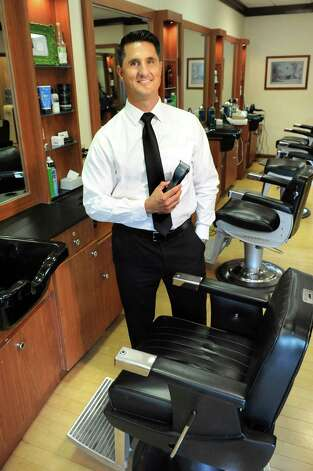 Barber Gregory Zorian Jr. at Gregory's Barbershop in Delmar , N.Y. (Cindy Schultz / Times Union) Photo: Cindy Schultz / 00033148A