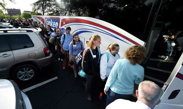 50 teens and five chaperones board a bus Friday morning Sept. 25, 2015 in Albany, N.Y.,  to New York City to see the Pope at Madison Square Garden this evening.  (Skip Dickstein/Times Union) Photo: SKIP DICKSTEIN / 10033481A