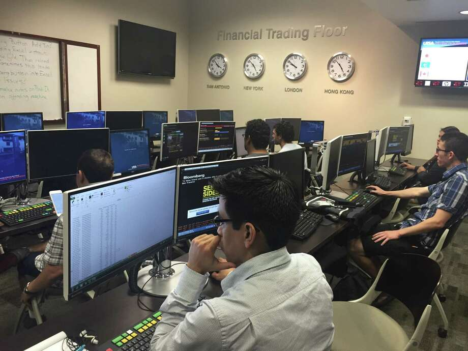UTSA Investment Society students use Bloomberg terminals at the school's Financial Trading Floor to research securities. Photo: UTSA