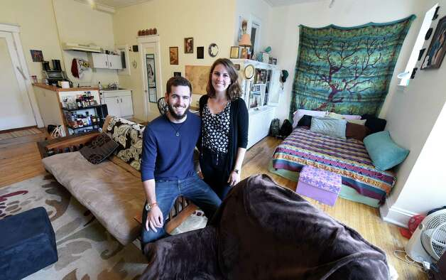 Andrew Baumgras and his fiancé Victoria Faccini enjoy a moment together in their apartment Tuesday morning Sept. 22, 2015 in Albany, N.Y.    (Skip Dickstein/Times Union) Photo: SKIP DICKSTEIN / 00033423A