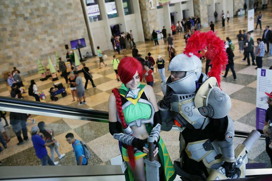 Husband and wife Francisco Cruz (right) dressed as Fernando the Knight and Beverly Villarreal (left)  dressed as Cassie the Huntress ride the escalator together during Twitchcon at Moscone West on Friday, September 25, 2015 in San Francisco, Calif. The characters are from a  game called Paladins and Cruz is an environment artist with the company. Photo: Lea Suzuki, The Chronicle